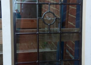 Triple glazed unit with traditional lead light